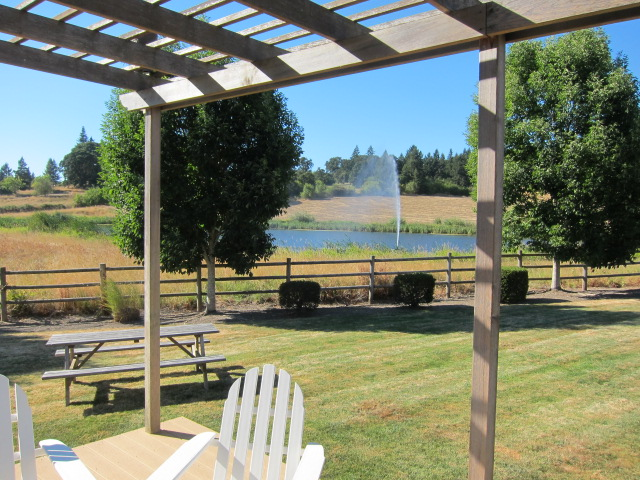 Large guest house at Stoller Vineyards sleeps 8, and includes this outdoor deck overlooking one of the ponds on the property.