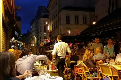 One of my favorite photos in Paris, sitting at a cafe watching the world go by.